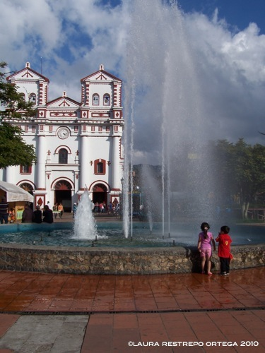 fountain and church Guatape Colombia