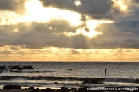 paddle surfing al atardecer