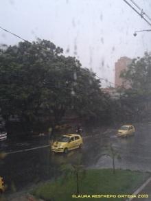 taxis en la lluvia