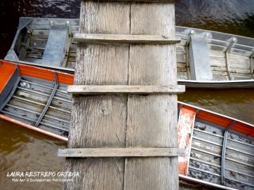 COL15-boats La Pedrera Amazonas Colombia bridge transport orange object horizontal